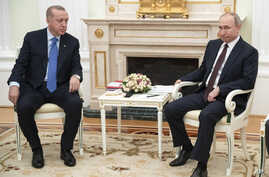 Russian President Vladimir Putin, right, and Turkish President Recep Tayyip Erdogan talk during their meeting in the Kremlin, in Moscow, Russia, March 5, 2020.