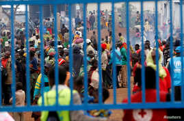 FILE - People who fled from Democratic Republic of Congo are seen gathered at the UNHCR-run Kyangwali refugee camp, in Kyangwali, Uganda, March 19, 2018.
