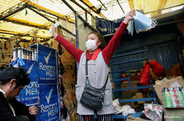 A vendor sells face masks to protect against the coronavirus, in a market in La Paz, Bolivia, March 11, 2020.