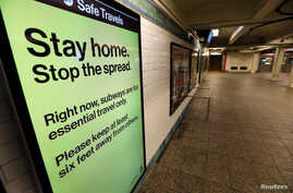 A message is seen on an electronic display inside a mostly empty 42nd Street subway station during the coronavirus outbreak in New York City, March 20, 2020.