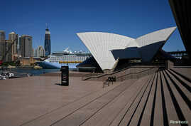 The mostly deserted steps of the Sydney Opera House, where scheduled public performances have been cancelled due to the coronavirus disease (COVID-19), are seen on a quiet morning in Sydney, Australia, March 18, 2020.
