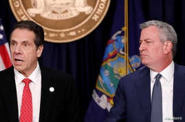 New York Governor Andrew Cuomo and New York City Mayor Bill de Blasio deliver remarks at a news conference regarding the first confirmed case of coronavirus in New York State in Manhattan borough, March 2, 2020.