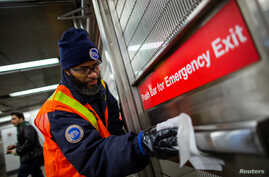MTA worker disinfects a subway station in the Manhattan borough of New York City, March 4, 2020.