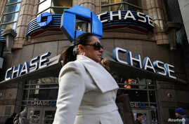 A woman passes by a JPMorgan Chase bank in Times Square in New York City,  March 7, 2019.