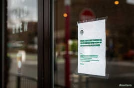 A Starbucks frequented by Syracuse University students displays precautionary measures as the threat of coronavirus spreads, New York, March 12, 2020.