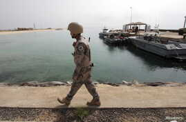 FILE - A Saudi border guard patrols Saudi Arabia's maritime border with Yemen along a beach on the Red Sea, near Jizan, April 8, 2015.