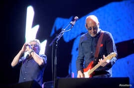 Guitarist Pete Townshend (R) and singer Roger Daltrey of British rock band The Who perform at the Azkena Rock Festival in Vitoria, Spain, June 18, 2016.