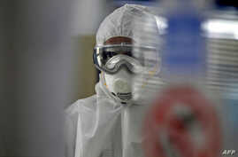 A technician tests swabs from patients for COVID-19 infection at the Central Health Laboratory in the Yemeni capital Sanaa,…