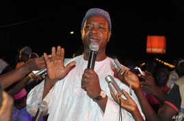 Independent presidential candidate Nuno Gomes Nabiam addresses his closing campaihn appearance on May 16 2014 in Bissau. …