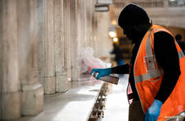 A Metropolitan Transportation Authority (MTA) staff uses a Lysol to clean a station at the lobby of Grand Central Station…