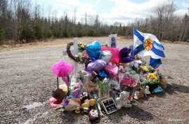 FILE PHOTO: The makeshift memorial that has been placed in the memory of Kristen Beaton, who was expecting her third child and…