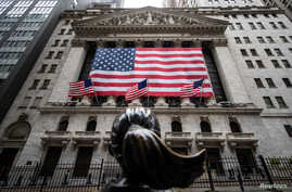 The New York Stock Exchange (NYSE) is seen in the financial district of lower Manhattan during the outbreak of the coronavirus…