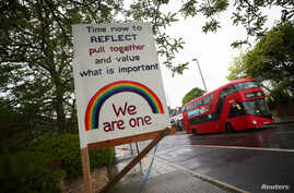 A rainbow sign and message is seen in Herne Hill, as the spread of the coronavirus disease (COVID-19) continues, London