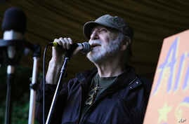 In this August 2014 photo provided by WXPN, Gene Shay performs during the Philadelphia Folk Festival. Shay, a folk DJ who spent…