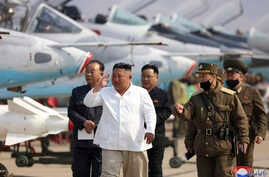 FILE - North Korean leader Kim Jong Un inspects an air defense unit in western area, North Korea.