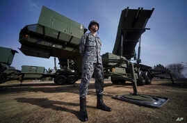 FILE - In this Jan. 18, 2018, file photo, a member of the Japan Ground Self-Defense Force stands guard next to a surface-to-air…
