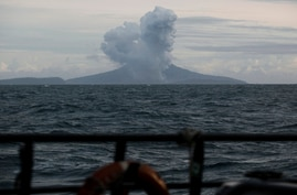 FILE - Mount Anak Krakatau spews volcanic material during an eruption as seen from an Indonesian Navy ship in the waters of Sunda Strait, Dec. 28, 2018.