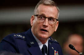 FILE - In this April 17, 2018 file photo, Air Force Gen. Terrence O'Shaughnessy testifies during a Senate Armed Services…