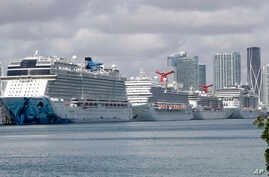 Cruise ships are docked at PortMiami, Tuesday, March 31, 2020, in Miami. The U.S. Coast Guard said Tuesday that it's working…