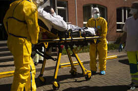 A coronavirus patient is transferred from a hospital to a home for the elderly by members of the medical staff of Klinicare in…