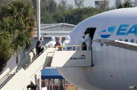 Passengers that came off the cruise ship Rotterdam Thursday, board a charter plane at Fort Lauderdale–Hollywood International…
