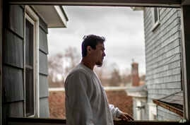 House painter Jose Martinez stands on his front porch in Greenfield, Mass, April 3, 2020. Martinez said a pandemic stimulus check could have helped cover at least a month's worth of expenses, if he had qualified.