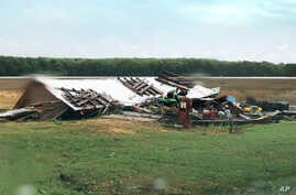In this image made from video provided by WLBT-TV strong storms pound parts of the Deep South, including this house and shed in Yazoo County, Miss., Sunday, April 12, 2020.