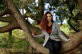Climate activist Jamie Margolin poses for a portrait in a tree in Seattle on April 5, 2020.