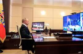 Russian President Vladimir Putin chairs a Security Council meeting at the Novo-Ogaryovo residence outside Moscow, Russia,…