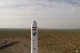 In this image taken from video, an Iranian rocket carrying a satellite is launched from an undisclosed site believed to be in…