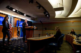 Secretary of State Mike Pompeo, accompanied by State Department spokeswoman Morgan Ortagus, left, speaks at a news conference at the State Department, April 29, 2020, in Washington.