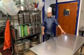 Chef Benjamin Velazquez closed his kitchen March 13, 2020 and laid off 10 workers when non-essential businesses were ordered closed to stop the spread of the coronavirus. (C. Simkins/VOA)