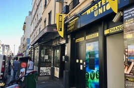 This Western Union office in Montreiuil has seen a drop in clientele. (L. Bryant/VOA)