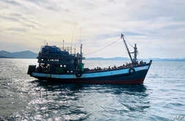 FILE - This handout photo released April 5, 2020, by the Malaysian Maritime Enforcement Agency shows a boat carrying suspected Rohingya refugees in Malaysian territorial waters. Similar boats are currently stranded in waters off Bangladesh.