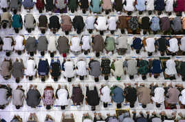 Muslim men perform an evening prayer called 'tarawih' marking the first evening of Ramadan despite concerns of the new coronavirus outbreak at the Islamic Centre Mosque in Lhokseumawe, Aceh province, Indonesia.