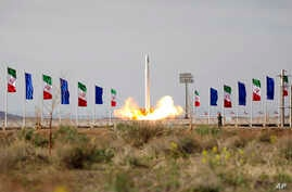 FILE - In this photo released April 22, 2020, by Sepahnews, an Iranian rocket carrying a satellite is launched from an undisclosed site believed to be in Iran's Semnan province.