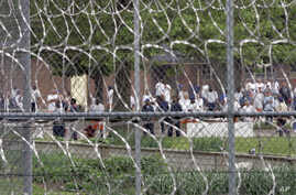FILE - Inmates are seen in the yard of the Lakeland Correctional Facility, in Coldwater, Michigan, June 1, 2007.