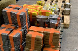 In this photo released March 31, 2020, by the San Diego Tunnel Task Force, Department of Homeland Security, a large haul of drugs that were seized in a cross-border tunnel running from warehouses in Tijuana, Mexico to San Diego are displayed in San Diego.