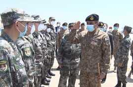 Pakistani military officials welcome Chinese military doctors at an Air Force base near Islamabad, April 24, 2020. (Courtesy ISPR)