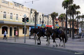 Mounted police officers patrol following the implementation of stricter social-distancing and self-isolation rules to limit the spread of the coronavirus, in the Manly suburb of Sydney, Australia, April 6, 2020.