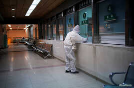 A woman wearing protective suit is seen at a hospital after the lockdown was lifted in Wuhan, capital of Hubei province and China's epicentre of the novel coronavirus disease (COVID-19) outbreak, April 13, 2020.