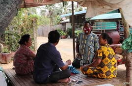 Hy Sokhom pictured with his family, as they gather at their home in Kien Svay district, Kandal province, Cambodia, April 12, 202
