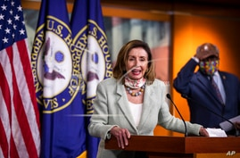 House Speaker Nancy Pelosi of Calif., with House Majority Whip James Clyburn of S.C., back right, speaks during a news…