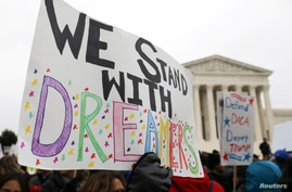 Demonstrators rally outside the U.S. Supreme Court as justices were scheduled to hear oral arguments in the consolidation of…