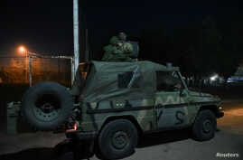 Greek soldiers are seen on a military vehicle at the Kastanies border crossing with Turkey's Pazarkule, in Kastanies, Greece…