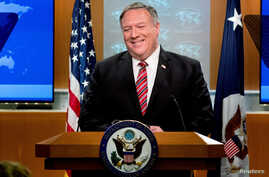 FILE - U.S. Secretary of State Mike Pompeo smiles during a news conference at the State Department, in Washington, U.S., April 29, 2020.