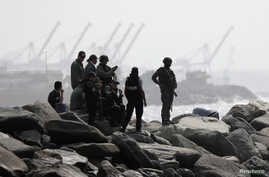 """FILE PHOTO: Members of the special forces unit are seen at a shore, after Venezuela's government announced a failed """"mercenary""""…"""