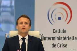 French President Emmanuel Macron takes part in a videoconference with region prefects at the crisis center of the Interior…