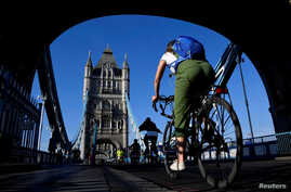 A cyclist is seen on Tower Bridge, following the outbreak of the coronavirus disease (COVID-19), London, Britain, May 15, 2020…