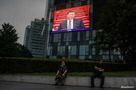 A screen at a department store shows Chinese PresidentXiJinping during the opening session of the CPPCC